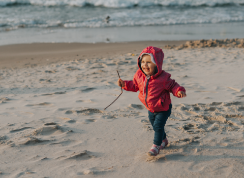 Young child playing on ocean beach